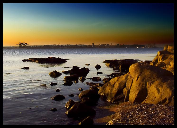 Stone In Focus | town, sky, rocks, shore, sea
