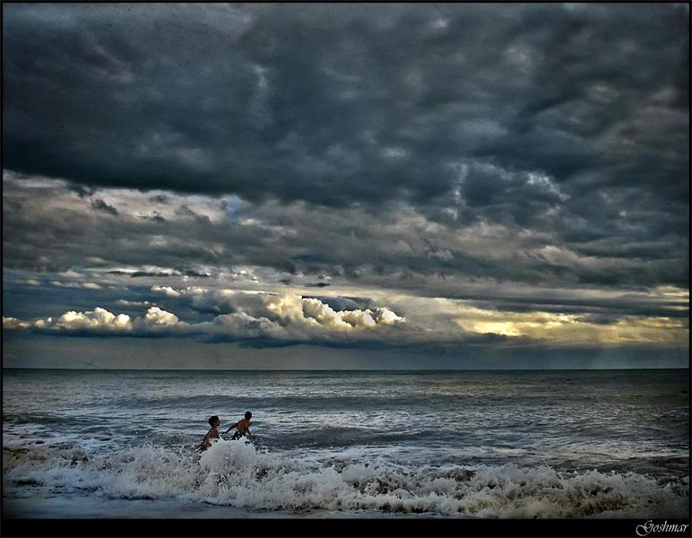 Before the rain falls   clouds, people, waves, sea, foam