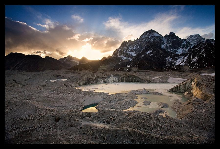 Ngozumpa glacier (no.1) | sun, water, rocks, glacier, mountains