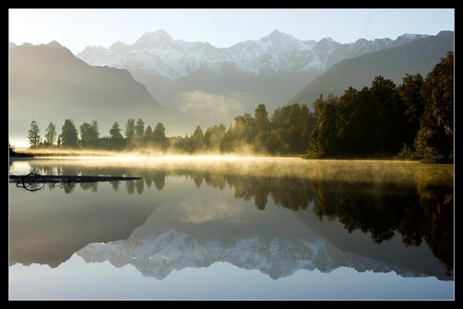 Dawn on a Lake   haze, lake, mountains, dawn, reflections