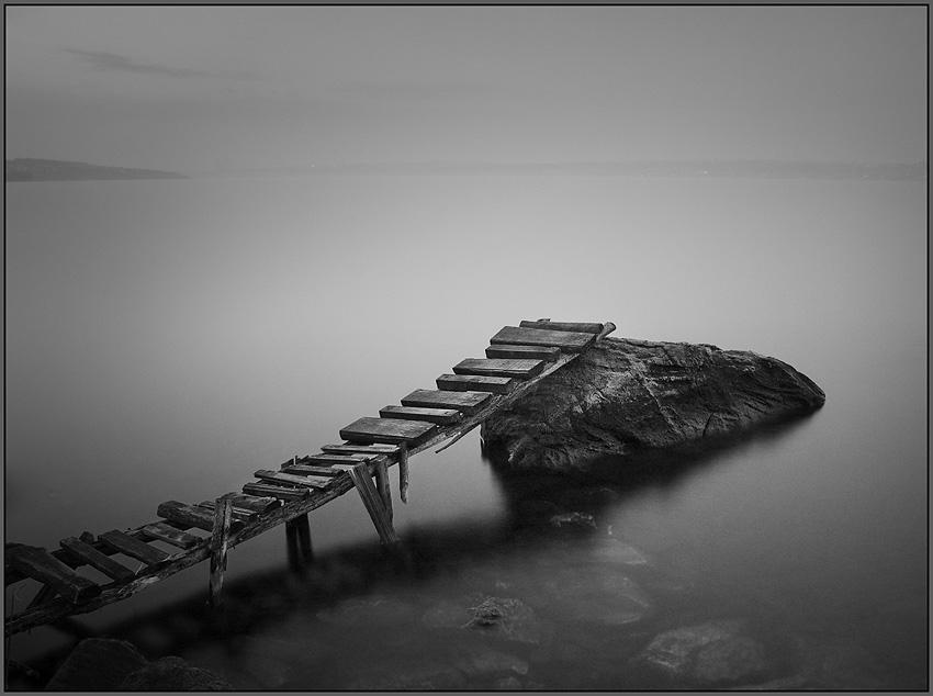 about the sturdy wooden bridge | rock, black and white, river, bridge