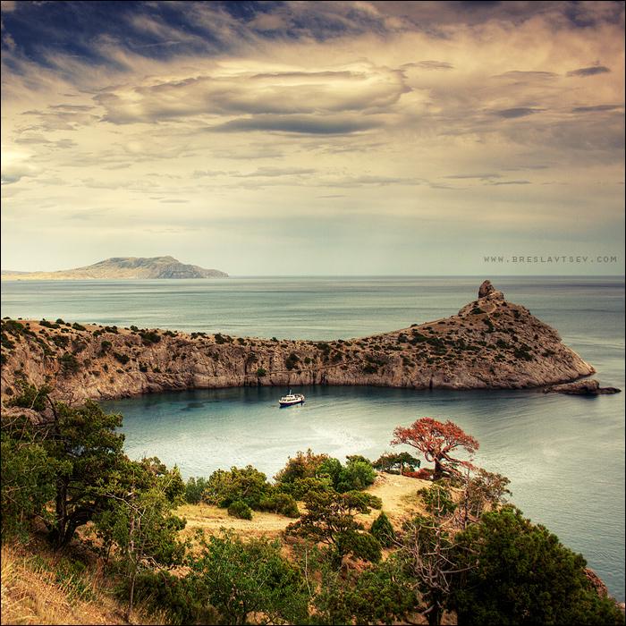 New World | rock, bay, yacht, sky, clouds, sea