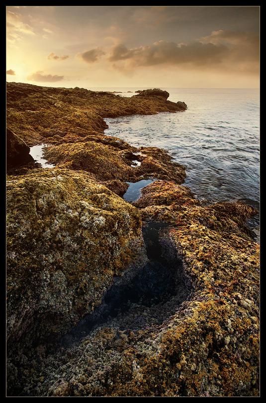 Hiding between rocks | rocks, sea, sky
