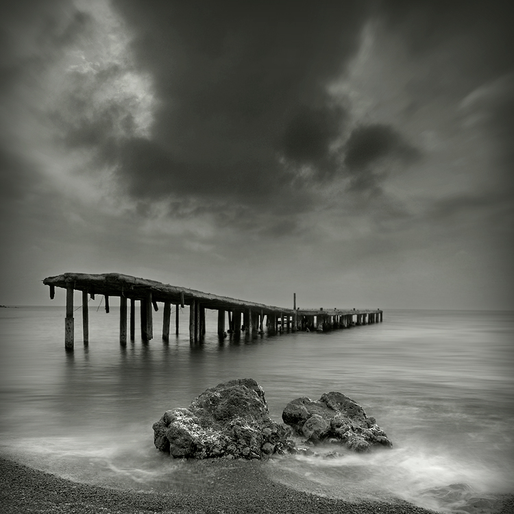 Where light died | wharf, black and white, rocks, sea
