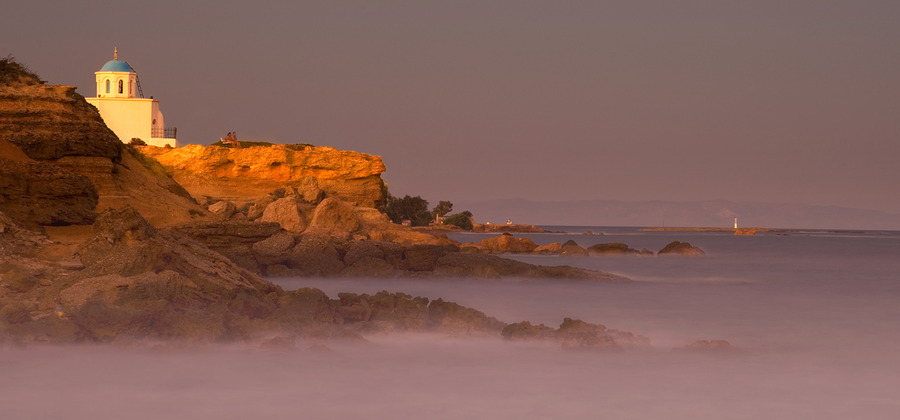 One of the sunsets | house, haze, sea, rocks