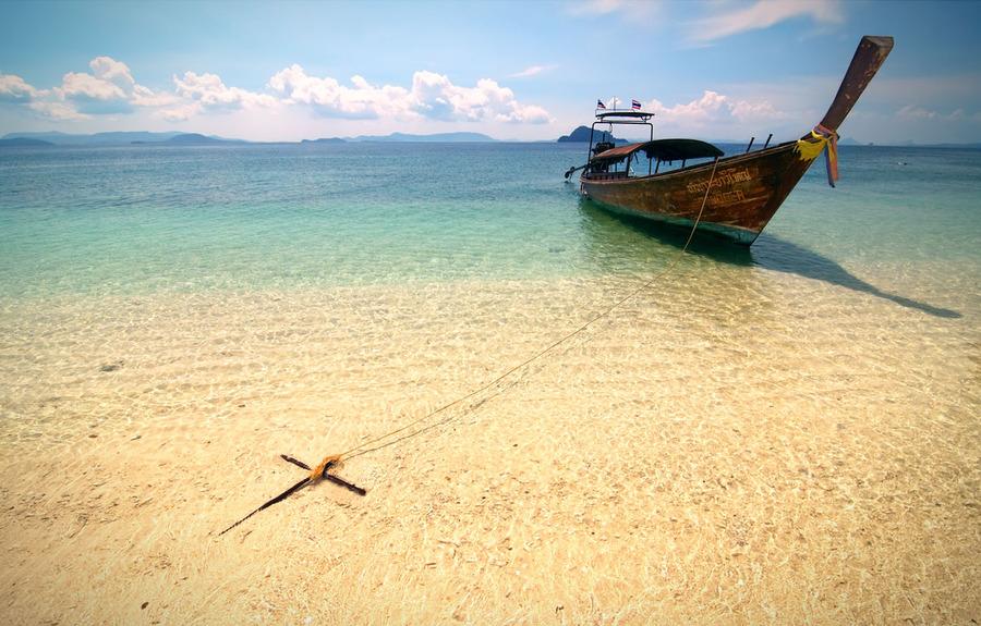 An island | sand, sea, boat