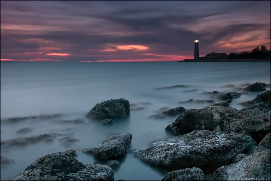 Onshore lighthouse  | shore, evening, water, skyline, dusk, sunset, rocks, stones, sea, sky, lighthouse