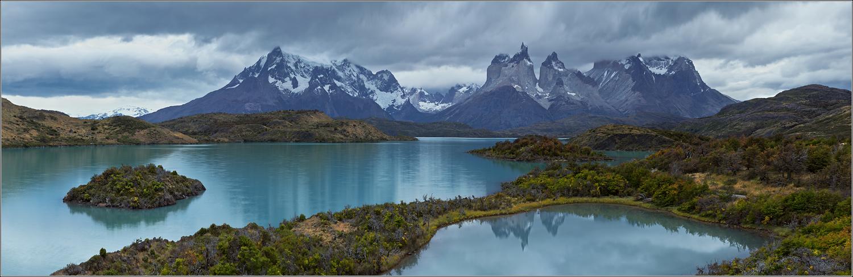 Mountain lake and island | island, mountain lake, snowy peaks, sky