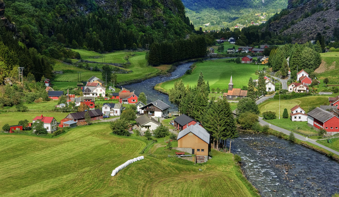 Village at the foot of the mountain | mountain, village, lawn, hillside