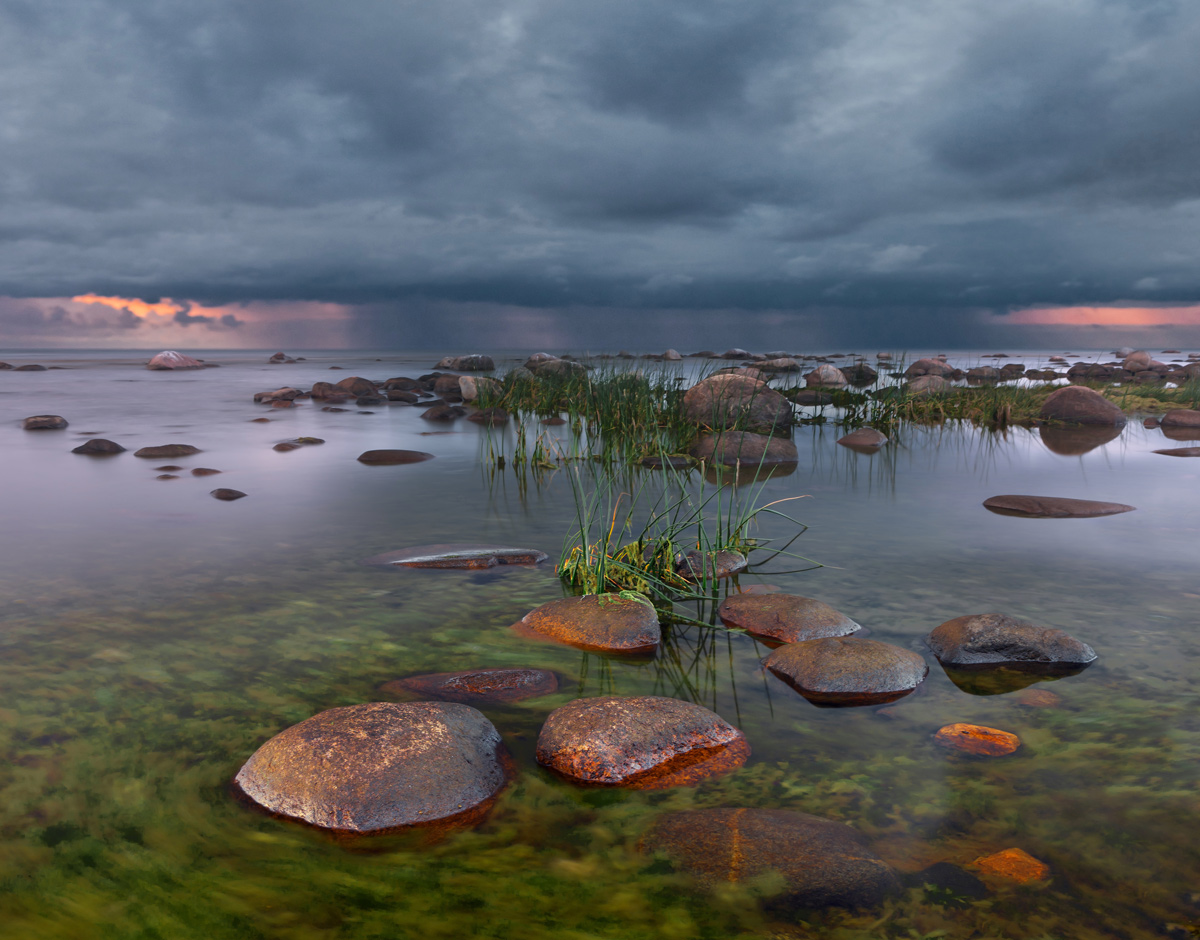 It rains on the horizon | landscape, green, clear, water, stones, sky, rainclouds, dark, rain, horizon