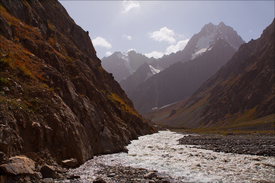 Beautiful sights of the mountains   mountain river, rocks, snowy peaks, sky