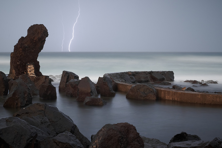 Coastal Ocean and lightning storm | stone in water, costal ocean, lighting, storm